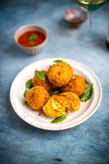 Mozzarella Arancini with Sweet & Spicy Marinara | DonalSkehan.com, Cheese stuffed rice balls, deep-fried until golden brown.