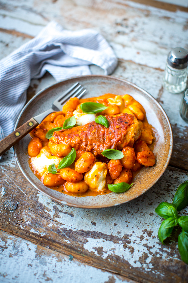 Prosciutto Chicken with Marinara Gnocchi | DonalSkehan.com, Crispy prosciutto wrapped in chicken and tossed in a rich tomato sauce!